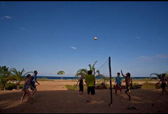Tourists playing volleyball along Lake Malawi